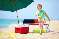 Cute boy walking the sea beach Royalty Free Stock Images