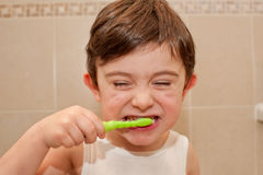 Cute boy washing his teeth Stock Photography