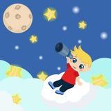 Cute boy watching through telescope at starry night Stock Photo