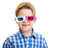 Cute boy wearing 3D glasses. Cute little boy wearing 3D glasses isolated over white Royalty Free Stock Photography
