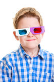 Cute boy wearing 3D glasses. Cute little boy wearing 3D glasses isolated over white Royalty Free Stock Image