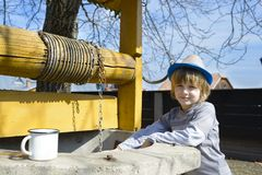 Cute Boy at Well Stock Photo