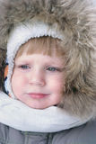 Cute boy in winter clothes Stock Images