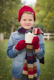 Cute Boy in Winter Clothing Holding Hot Cocoa Mug Outside Stock Photography