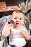 Cute Boy With Cellphone Royalty Free Stock Photography