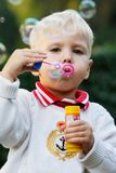 Cute Boy With Soap Bubbles Stock Photos