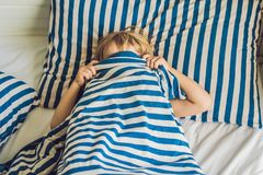 The cute boy woke up in his bed. Children sleep concept.  Royalty Free Stock Photos