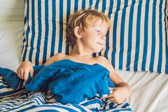 The cute boy woke up in his bed. Children sleep concept.  Stock Photography