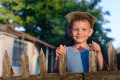Cute Boy at the Wooden Fence Smiling at Camera Royalty Free Stock Photo