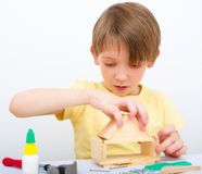 Boy working with hammer and nail. Cute boy working with hammer and nail Royalty Free Stock Photos