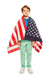 Cute boy wrapped in American flag Stock Photography