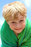 Cute Boy Wrapped in Beach Towel Stock Image