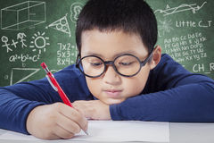 Cute boy writing idea on the paper Royalty Free Stock Photos