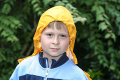 Cute boy with yellow rain jacket Stock Images