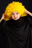 Cute boy in yellow wig Stock Photos
