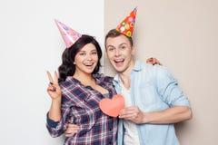 Cute boyfriend and girlfriend on celebration of Stock Photos