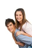 Cute boyfriend piggybacking his girlfriend. Royalty Free Stock Photos