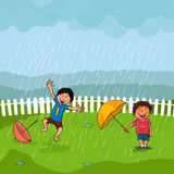 Cute boys in rain for Monsoon Season concept. Royalty Free Stock Photos