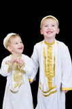 Cute boys with traditional Arabian dress. Cute little 3yr and 5yr old boys wearing traditional Arabian thobes for the purpose of asking for Ramadan treats Royalty Free Stock Image