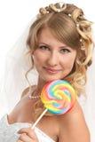 Cute bride. Closeup portrait of cute bride with lollypop Stock Photography
