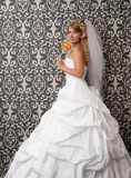 Cute bride. Portrait of cute bride with lollypop Royalty Free Stock Photos