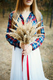 Cute Bride in American style. Fine young woman wearing a wedding dress with a plaid shirt Royalty Free Stock Images