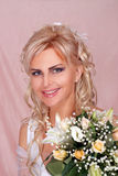 Cute bride with flowers Royalty Free Stock Images