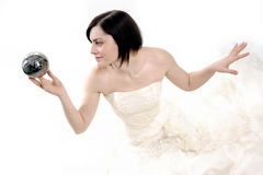 Cute bride holding a magic silver ball royalty free stock images
