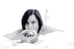Cute bride with silver magic ball Stock Images
