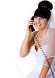 Cute bride speaks on the phone Royalty Free Stock Photo