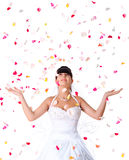 Cute bride throws rose petals Royalty Free Stock Image