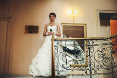 Cute bride in wedding dress posing  on the background  miror Royalty Free Stock Photo
