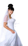Cute bride in a white dress Royalty Free Stock Photography