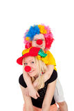 Cute bright clowns. Cute little boy and his young beautiful mother dressed as the clowns Royalty Free Stock Images