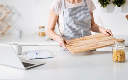 Cute bright lady preparing for cooking Royalty Free Stock Photo