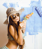 Cute bright woman in sunglasses and hat with cocktail in bikini in studio Royalty Free Stock Images