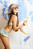 Cute bright woman in sunglasses and hat with cocktail in bikini in studio Stock Images