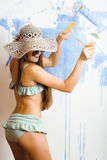 Cute bright woman in sunglasses and hat with cocktail in bikini in studio Royalty Free Stock Photo