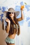 Cute bright woman in sunglasses and hat with Royalty Free Stock Image