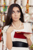 Cute Broke Woman at  Shopping Checking Wallet Stock Photography
