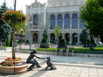 Cute bronze statue of girl playing with her dog. In Budapest Hungary Stock Photo