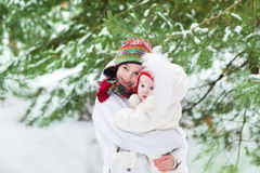 Cute brother and his baby sister in snowy park Royalty Free Stock Images