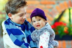 Cute brother and sister, colorful outdoors. Outdoor portrait of cute brother and sister Royalty Free Stock Images
