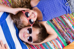 Cute brother and sister holding each others heads Stock Photo