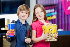 Cute Brother And Sister Holding Snacks At Cinema Royalty Free Stock Photo