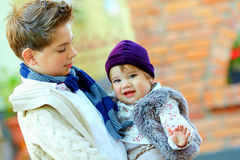 Cute brother and sister. Outdoor portrait of cute brother and sister Stock Photos