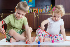 Cute brother and sister painting Stock Images