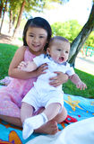 Cute Brother and Sister in Park Royalty Free Stock Photo