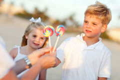Cute Brother and Sister Picking out Lollipop Royalty Free Stock Image
