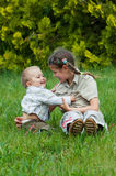 Cute brother and sister playing Royalty Free Stock Photo